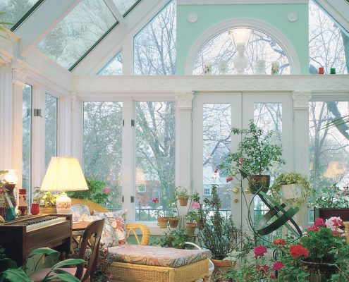 Glass Cathedral Sunroom or Solarium with Wood Interior